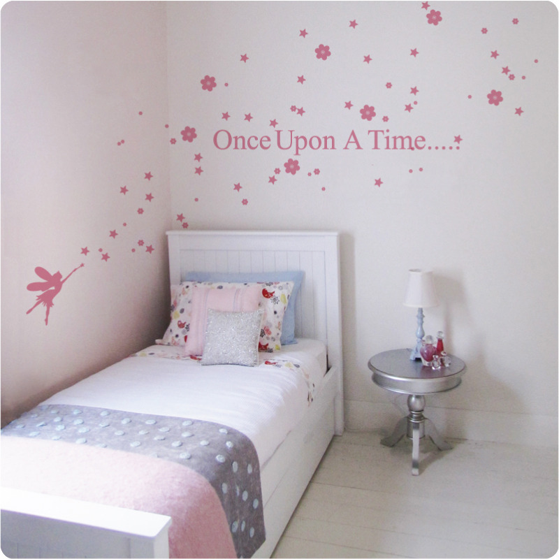 Fairy Story removable wall stickers behind a bed and round silver table