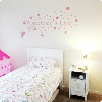 Fairy Story removable wall stickers behind a bed and side table