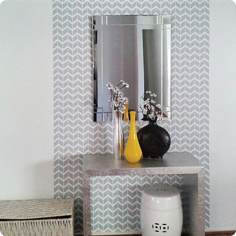 Herringbone removable wallpaper Australia Curio and Curio with flower vases in front