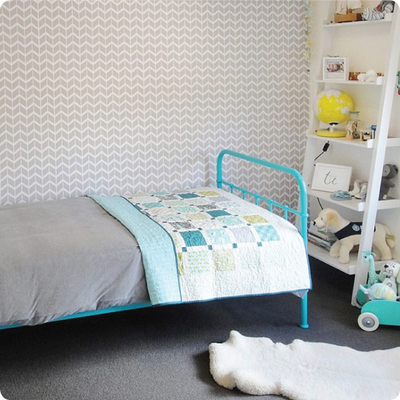 Herringbone removable wallpaper Australia Curio and Curio with bed in blue frame in front