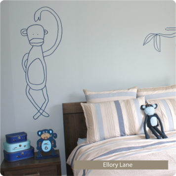 Jane Reiseger Monkey removable wall stickers behind the bed and side table