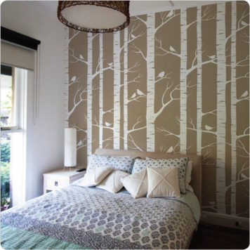 Birch wallpaper Australia by Ink and Spindle behind a bed and side table
