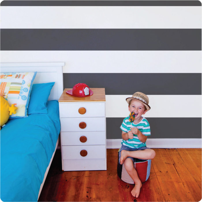 Nautical large stripes removable wallpaper Australia for homes with little boy sitting in front