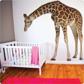 Real-life removable giraffe wall sticker watch over a sleeping baby