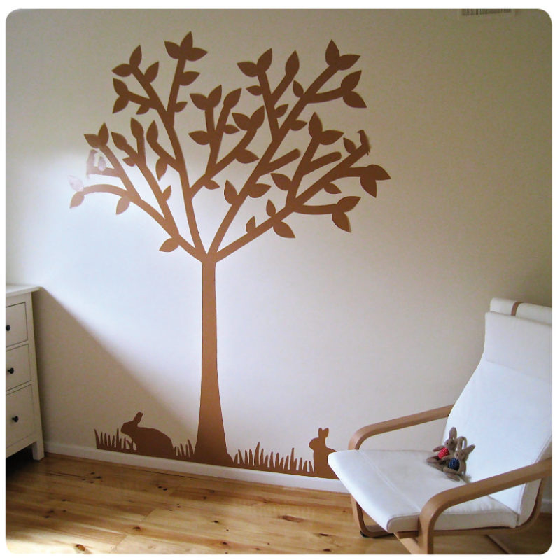 Tree silhouette removable wall sticker behind a chair