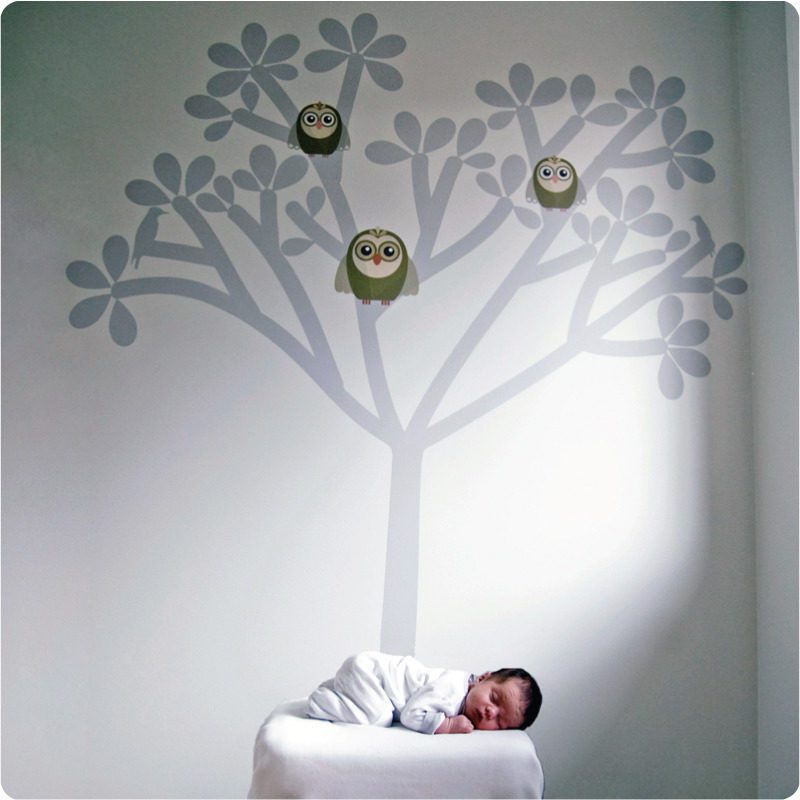 Tree silhouette removable wall sticker with baby in front sleeping on top of small bed