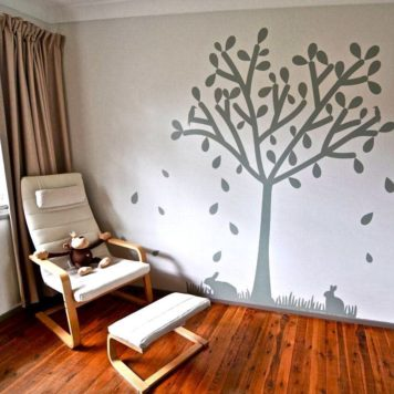 Tree silhouette removable wall sticker behind a lounge chair
