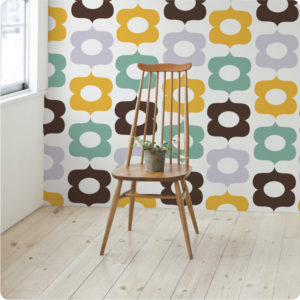 Flowers removable wallpaper Australia with wooden chair in front