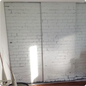 white brick wallpaper covering mirrored doors