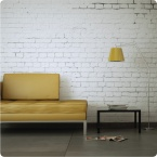 White Brick removable wallpaper Australia with yellow floor lamp and yellow sofa in front