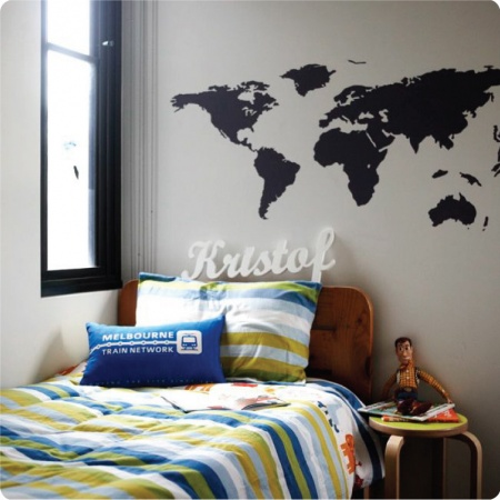 Bedroom with World Map removable wall stickers by The Wall Sticker Company behind a bed