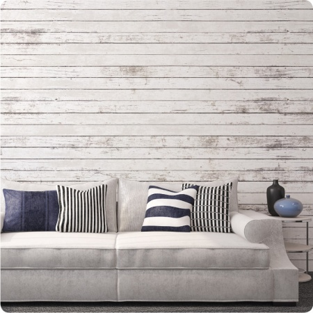 White Wood wallpaper with couch and side table in front