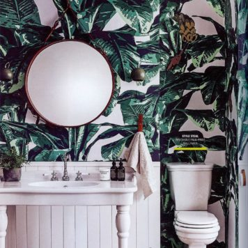 Tropical removable wallpaper in a bathroom as seen in Real living
