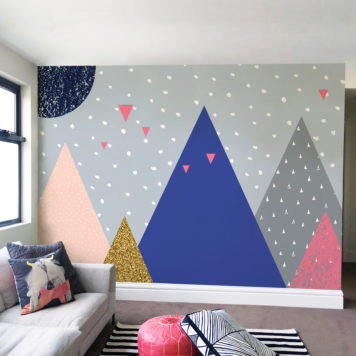 Colourful mural in a living room with a couch and cushions