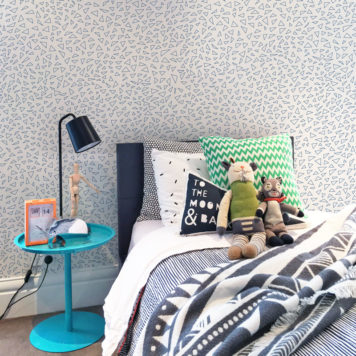 Triangle wallpaper in blue in a bedroom