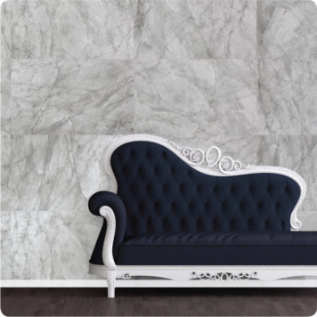 Marble removable wallpaper behind a navy chaise