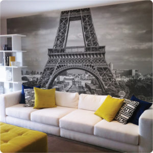 Paris removable mural behind a white couch in a living room