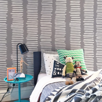 Striped wallpaper in grey in a child's bedroom