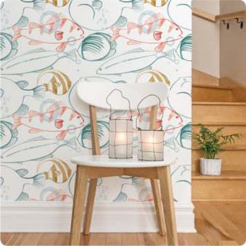 A 2 lamps sits on a chair in front of the Under the Sea wallpaper