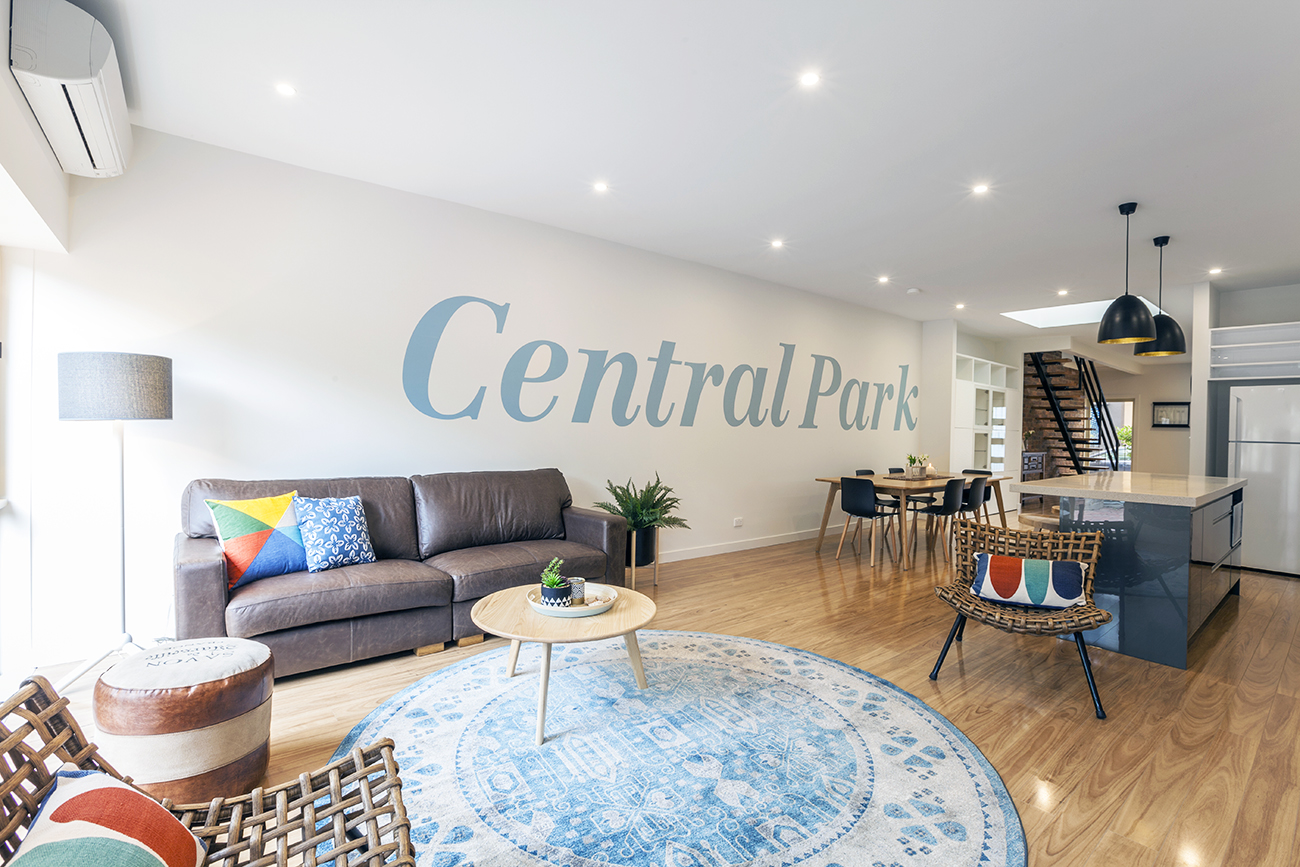 OPen plan home with large letters on wall Central Park