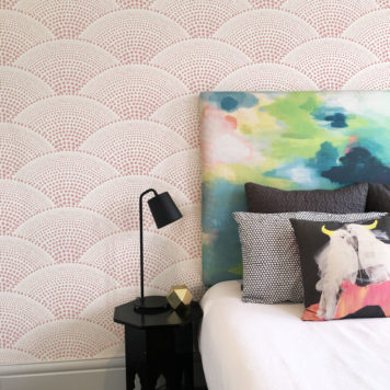 Bedroom with water coloured bedhead and pink wallpaper