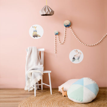Pink wall with decals and pom poms