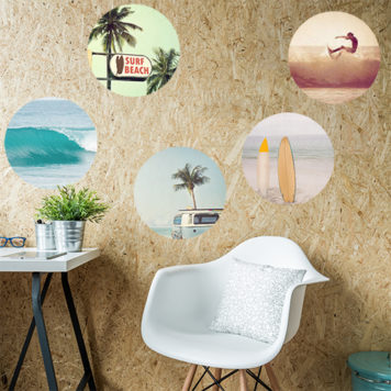 Modern white chair sits at desk in front of a wall with round trips surf decals