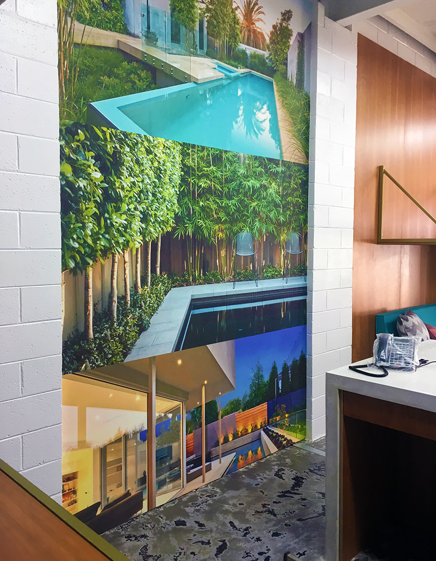 Wall mural with photographs in display suite