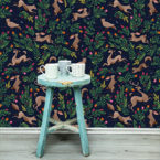 Redwoods wallpaper designed by Fleur Harris, see in Navy colour way, behind an aqua table with teacups