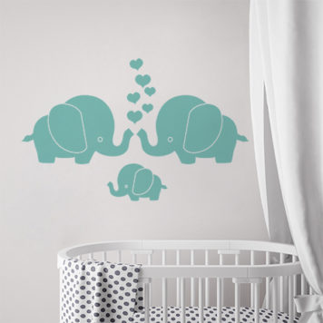 Elephant Family wall sticker above a cot in a nursery