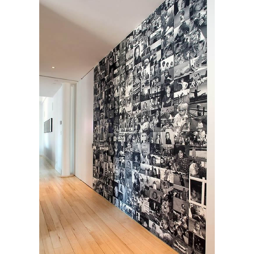 Image of a black and white photo collage on a hallway wall