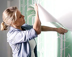 Shaynna Blaze installing removable wallpaper